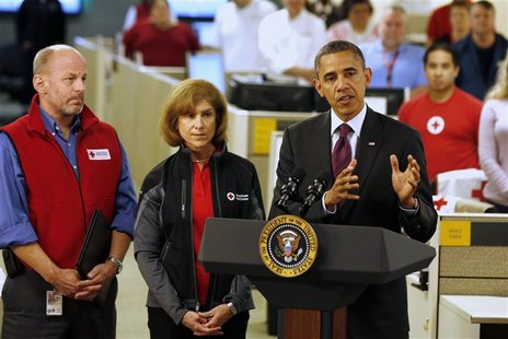 U.S. President Barack Obama (R) talks about damage done by Hurricane Sandy and rescue efforts while at the National Red Cross Headquarters i
