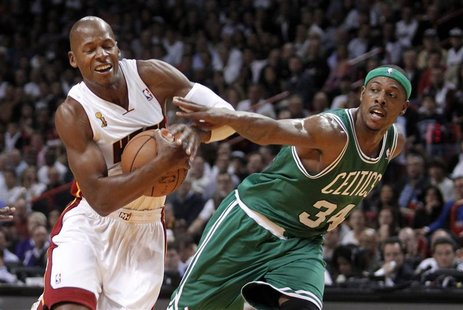 Boston Celtics forward Paul Pierce (R) fouls Miami Heat guard Ray Allen in the first half of their NBA basketball game in Miami, Florida Oct