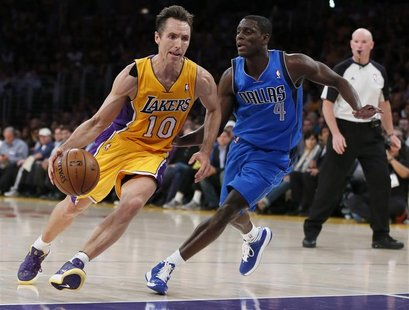 Los Angeles Lakers point guard Steve Nash (10) drives up the key against Dallas Mavericks point guard Darren Collison (4) in the first quart