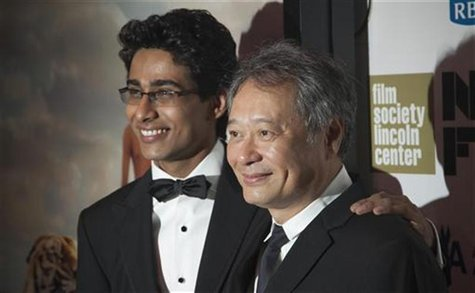 "Cast member Suraj Sharma (L) and Director Ang Lee attend the opening night gala presentation of film ""Life Of Pi"" at the 50th New York Film"