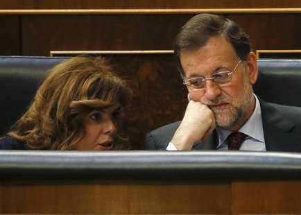 Spain's Prime Minister Mariano Rajoy (R) listens to Deputy Prime Minister Soraya Saenz de Santamaria at the Spanish parliament before his sp