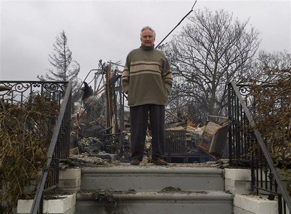 Bruce Bavasso stands in front of what is left of his home in the Belle Harbor neighborhood of New York, October 30, 2012. Bavasso's three-st