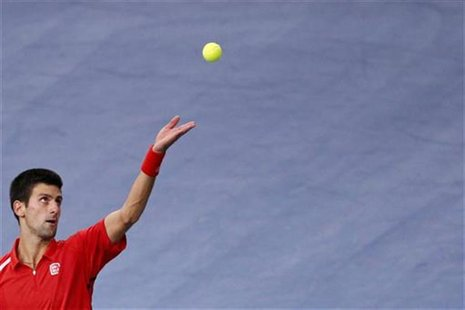 Novak Djokovic of Serbia serves the ball during his match against Sam Querrey of the U.S. during the Paris Masters tennis tournament October