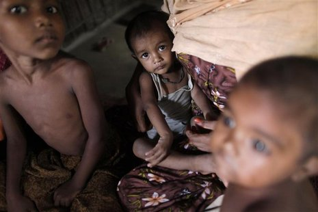 Rohingya children, who fled the recent violence of Myanmar, sit in a house as they hide with other relatives in Teknaf October 30, 2012. REU