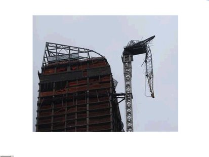 A damaged crane hangs over West 57th Street in New York City. Photo courtesy of Reuters.