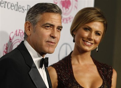 Actor George Clooney and girlfriend Stacy Keibler arrive at the 26th Carousel of Hope Ball in Beverly Hills, California October 20, 2012. RE