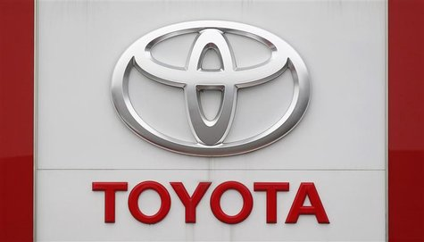 The Toyota logo is seen outside a Japan's Toyota Motor Corp car dealership in Hoenheim near Strasbourg, eastern France October 10, 2012. REU