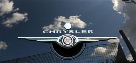 Clouds are reflected on a Chrysler PT Cruiser at a Chrysler dealership in Rome April 30, 2009. REUTERS/Tony Gentile