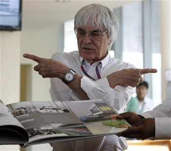 Formula One supremo Bernie Ecclestone gestures during the presentation of a commemorative book presented to him on the occasion of his birth