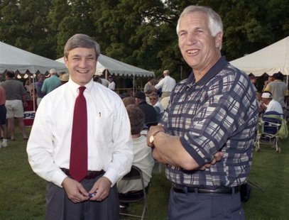Penn State University President Graham Spanier (L) and Second Mile founder and Penn State assistant football coach Jerry Sandusky, attend th