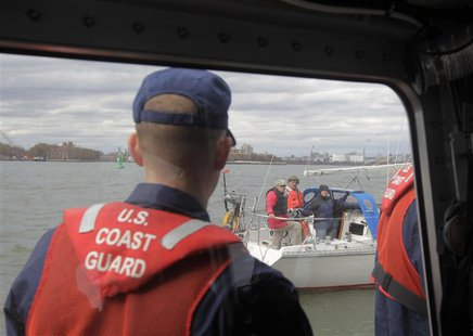 Members of the U.S. Coast Guard stop a sailboat during a patrol of New York Harbor October 31, 2012. REUTERS/Brendan McDermid