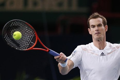 Andy Murray of Britain returns the ball to Poland's Jerzy Janowicz during the Paris Masters tennis tournament November 1, 2012. REUTERS/Beno