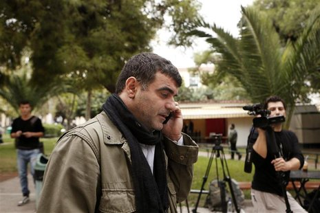 Greek editor Costas Vaxevanis speaks on the phone outside a courthouse in Athens November 1, 2012. REUTERS/Yorgos Karahalis