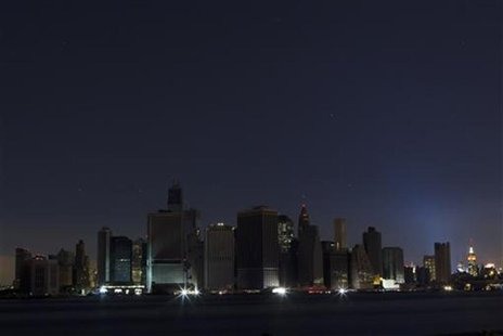 A largely powerless downtown Manhattan stands under a night sky due to a power blackout caused by Hurricane Sandy in New York October 31, 20