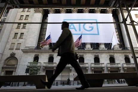 A banner for American International Group Inc (AIG) hangs on the facade of the New York Stock Exchange, Ocotber 16, 2012. REUTERS/Brendan Mc