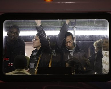 People travel in a bus from Manhattan back to the Brooklyn borough in the aftermath of Hurricane Sandy in New York November 1, 2012. REUTERS