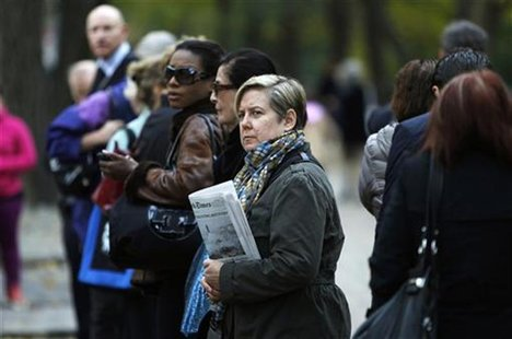 People line up for the bus on the Upper East Side of Manhattan in the aftermath of Hurricane Sandy in New York October 31, 2012. REUTERS/Car