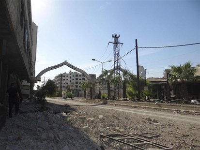 A view shows buildings damaged by what activists say were missiles fired by a Syrian Air Force fighter jet loyal to Syria's President Bashar