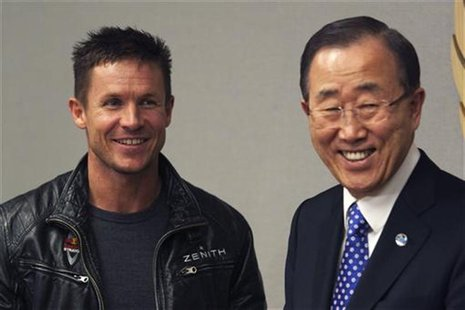 Pilot Felix Baumgartner of Austria (L) and U.N. Secretary-General Ban Ki-moon smile as they talk to each other during a photo opportunity at