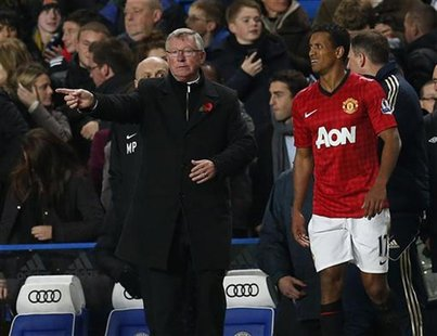 Manchester United's manager Alex Ferguson gestures as Nani looks on during their English League Cup soccer match against Chelsea at Stamford