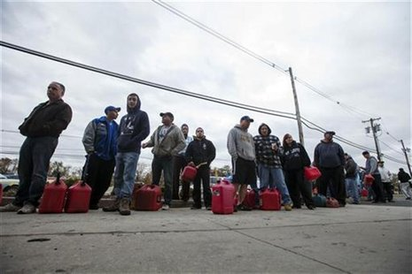 People affected by the power outages from Hurricane Sandy wait in a 2hr line at a gas station to purchase fuel for generators in Madison Par