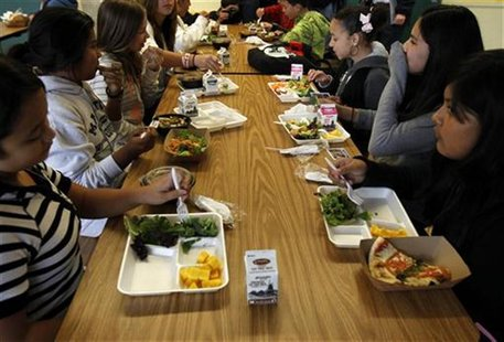 Students sit down to eat a healthy lunch at Marston Middle School in San Diego, California, March 7, 2011. REUTERS/Mike Blake