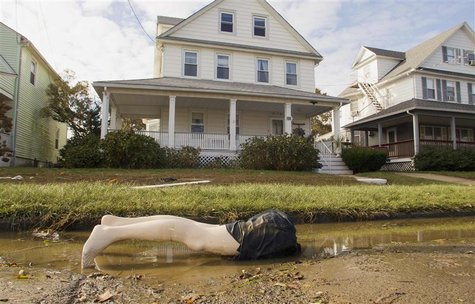 The bottom half of a mannequin lies on 8th Avenue in Belmar, New Jersey November 2, 2012 in the aftermath of Hurricane Sandy. REUTERS/Tom Mi