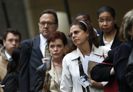 Job seekers stand in line to meet with prospective employers at a career fair in New York City, in this October 24, 2012 file photo. REUTERS