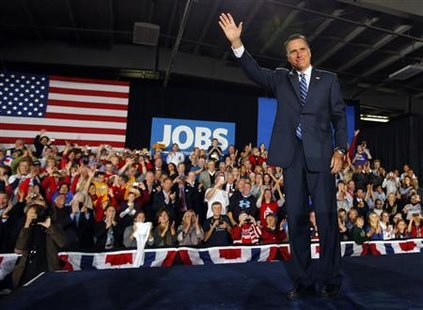 Republican presidential nominee Mitt Romney takes the stage to deliver a speech in West Allis, Wisconsin November 2, 2012. Credit: Reuters/Brian Snyder