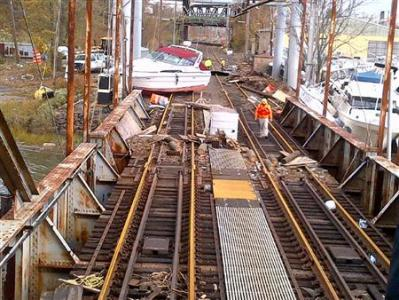 Boats, dumpsters and other debris block the North Jersey Coast Line rail track at Morgan Draw Bridge in New Jersey in the aftermath of super storm Sandy in this October 31, 2012