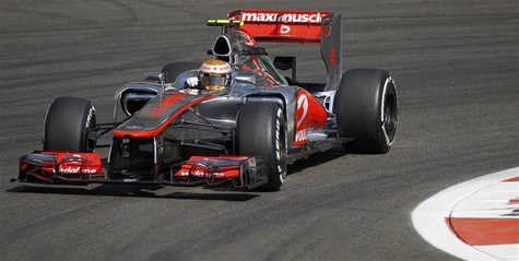 McLaren Formula One driver Lewis Hamilton of Britain drives during the first practice session of the Abu Dhabi F1 Grand Prix at the Yas Mari