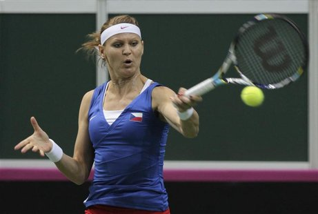 Czech Republic's Lucie Safarova returns a ball to Serbia's Ana Ivanovic during their final match of the Fed Cup tennis tournament in Prague