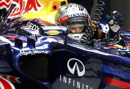 Red Bull Formula One driver Sebastian Vettel of Germany sits in his car during the qualifying session of the Abu Dhabi F1 Grand Prix at the