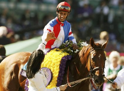 Horse Groupie Doll with Rajiv Maragh in the iron celebrates winning first place during the running of the Breeders' Cup Filly & Mare Sprint