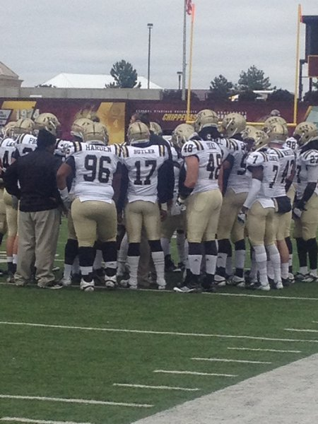 The Broncos huddle on the sideline. WMU @ CMU 11/3/12