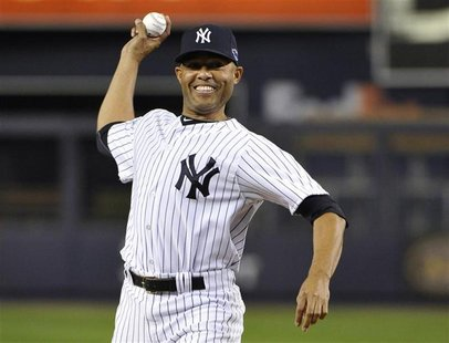Injured New York Yankees closer Mariano Rivera throws out the ceremonial first pitch before Game 3 of their MLB ALDS baseball playoff series