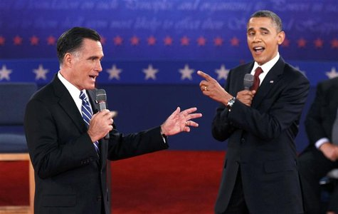 U.S. Republican presidential nominee Mitt Romney (L) and U.S. President Barack Obama answer a question at the same time during the second U.