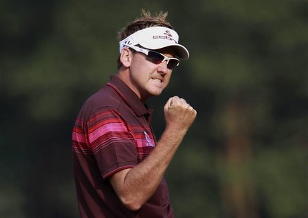 Ian Poulter of England celebrates on the 18th green after winning the WGC-HSBC Champions Tournament at Mission Hills in the southern Chinese