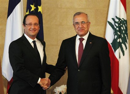 France's President Francois Hollande (L) shakes hands with Lebanon's President Michel Suleiman at the presidential palace in Baabda, near Be