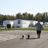 Jason Calvin walks his dogs in Joplin, Missouri October 20, 2012 at the FEMA mobile home park where he lives. An affordable place to live in