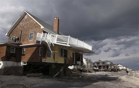 A home damaged by Hurricane Sandy is seen between the ocean and Rt 35 in Bayhead, New Jersey, November 2, 2012 in this handout image courtes