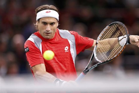 David Ferrer of Spain returns the ball during his final men's singles match against Jerzy Janowicz of Poland at the Paris Masters tennis tou