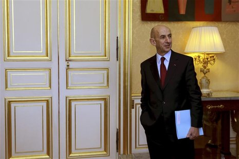 French General commissioner for investment Louis Gallois waits outside France's Prime Minister Jean-Marc Ayrault's office to hand over his r
