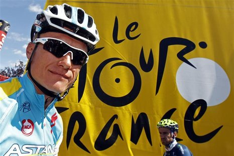 Astana Pro Team rider Alexandre Vinokourov of Kazakhstan arrives at the sign-in podium before the start of the seventh stage of the 99th Tou