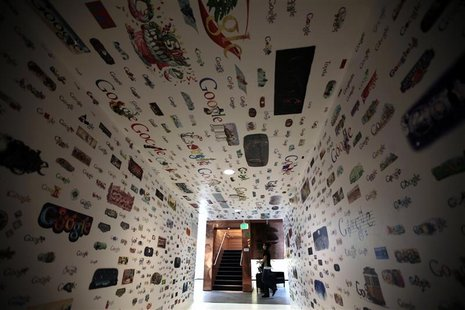 A woman walks past a tunnel of Google homepage logos at the Google campus near Venice Beach, in Los Angeles, California January 13, 2012. RE