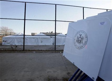 Voting machines are delivered to a make-shift polling center in the playground of a flood damaged school in the Rockaways neighborhood of th