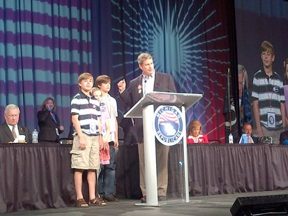 Garrett Huizenga is standing to the immediate right of US House Rep. Bill Huizenga (R-Zeeland) during an appearance at the May 19, 2012 Michigan Republican Party Convention in Detroit (photo courtesy Huizenga for Congress campaign)