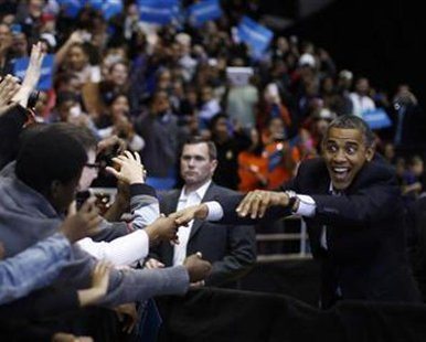 U.S. President Barack Obama greets supporters during an election campaign rally in Cincinnati, Ohio, November 4, 2012.  REUTERS/Jason Reed