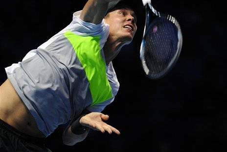 Tomas Berdych of Czech Republic serves to Andy Murray of Britain during their men's singles tennis match at the ATP World Tour Finals in the