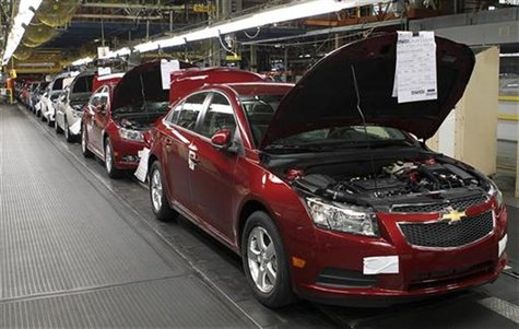 Fully assembled Chevrolet Cruze cars reach the end of the assembly line at the General Motors Cruze assembly plant in Lordstown, Ohio July 2